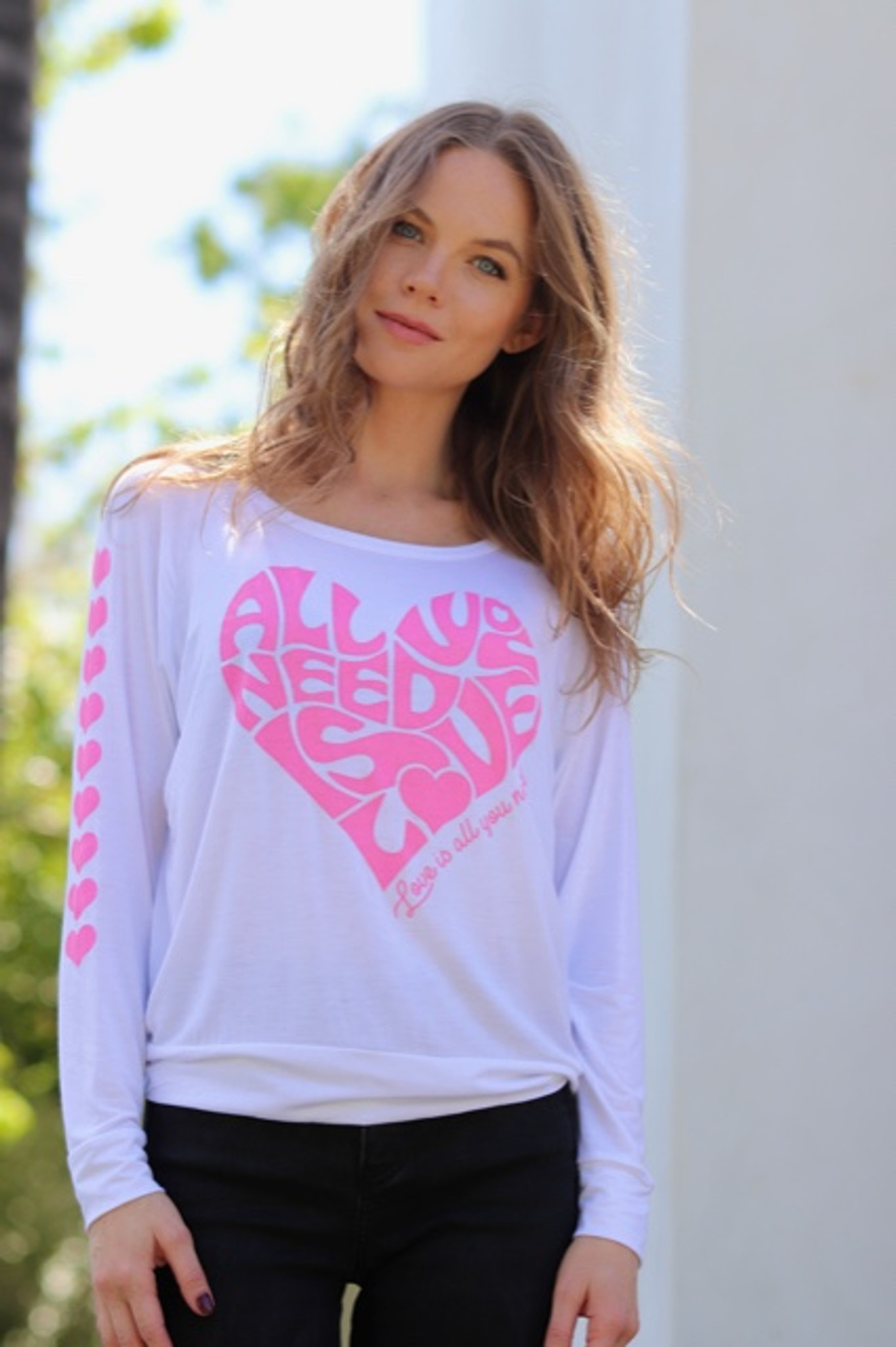 ALL YOU NEED IS LOVE L/S TEE with a PINK HEARTS GRAPHIC on ARM (White)