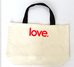 RED HEART NATURAL CANVAS TOTE with LOVE. on back.