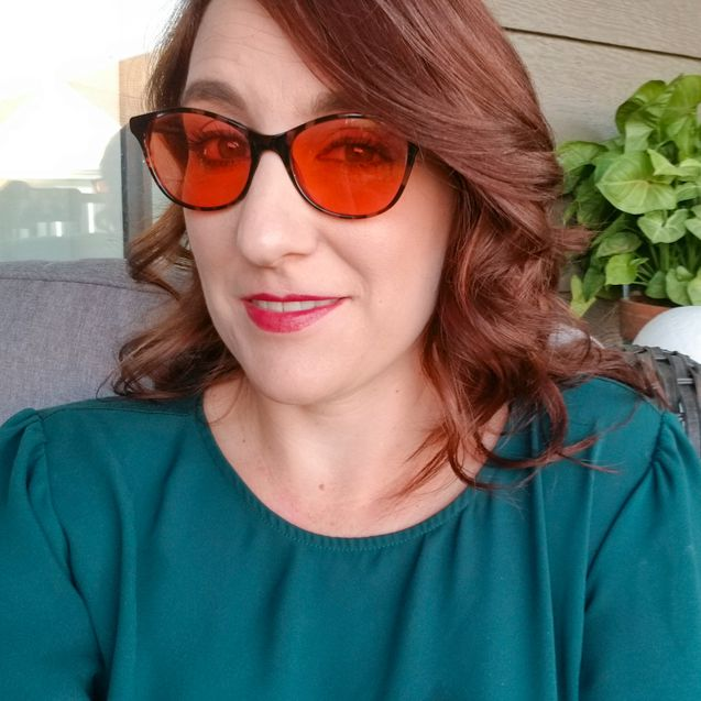 Aimee wearing Audrey indoor TheraSpecs blue light filtering glasses
