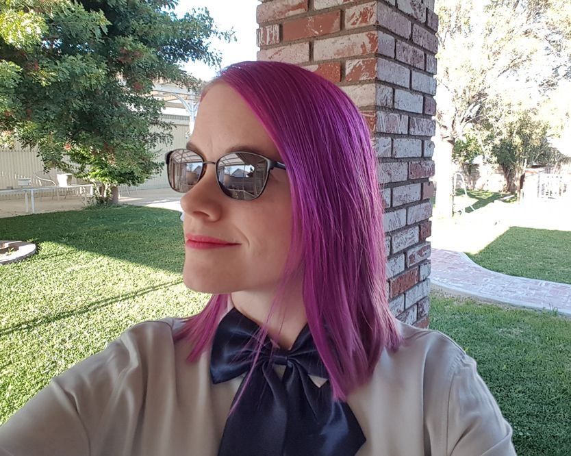 Ashley wearing outdoor TheraSpecs for migraines