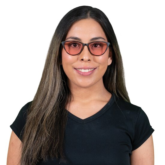 Woman wearing Betty TheraSpecs in Brown with indoor lenses