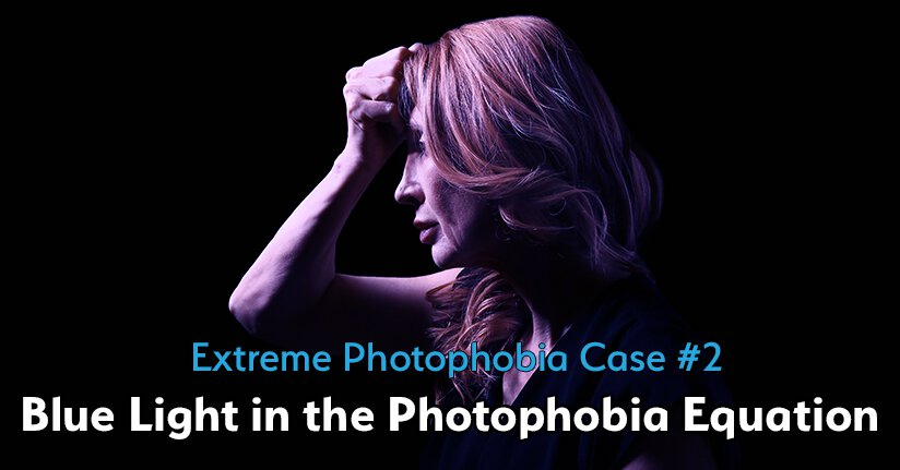 Woman with extreme photophobia reacting to blue light in dark space