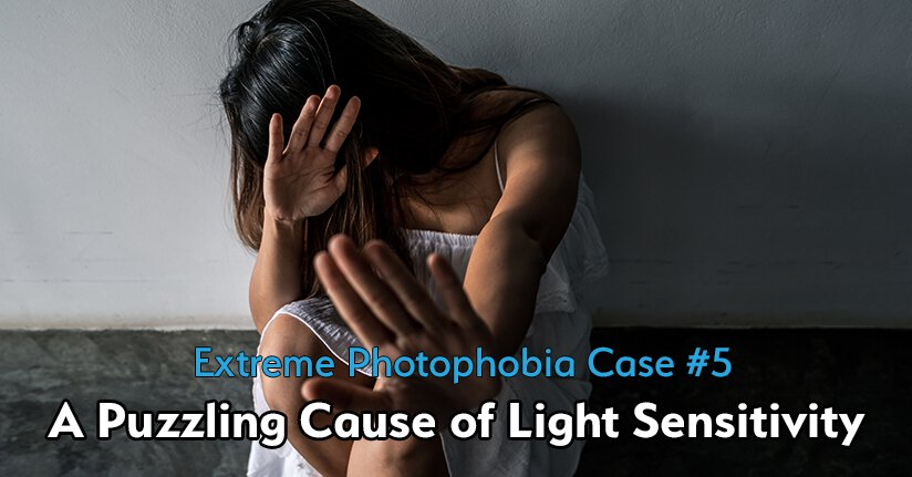 Woman with extreme photophobia turning her head and using her hand to block bright light