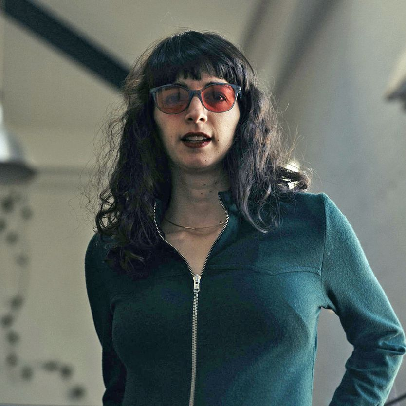 Hanna wearing indoor TheraSpecs, Audrey blue frame style