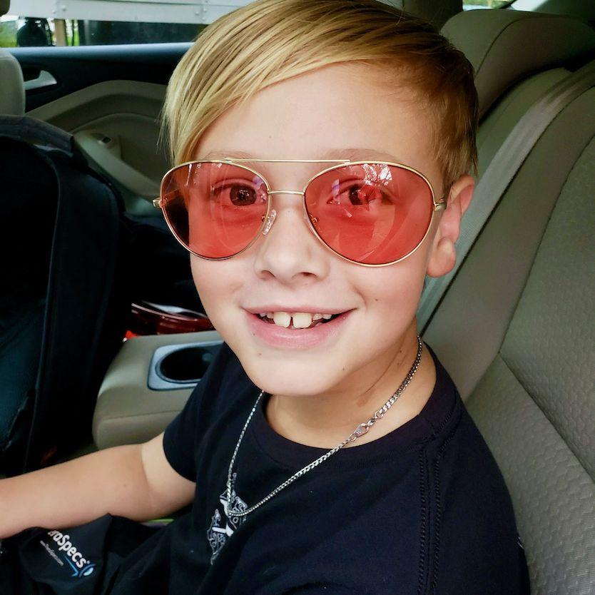 Jen's son wearing Pilot TheraSpecs