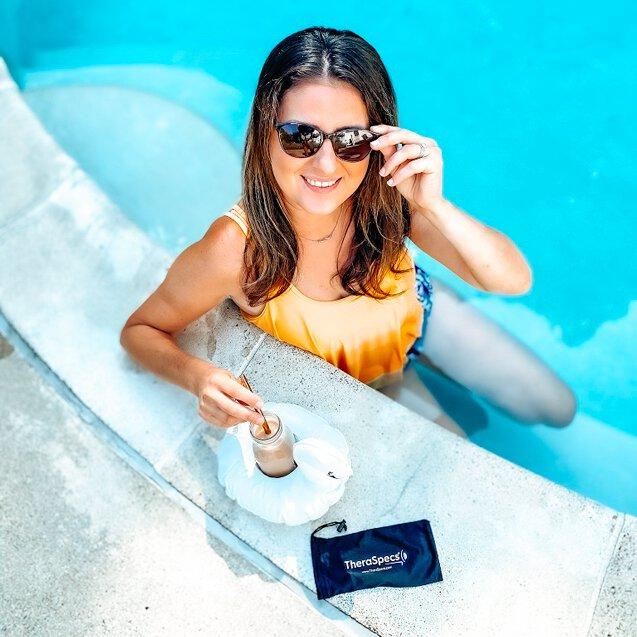Marina wearing Audrey outdoor TheraSpecs blue light blocking sunglasses