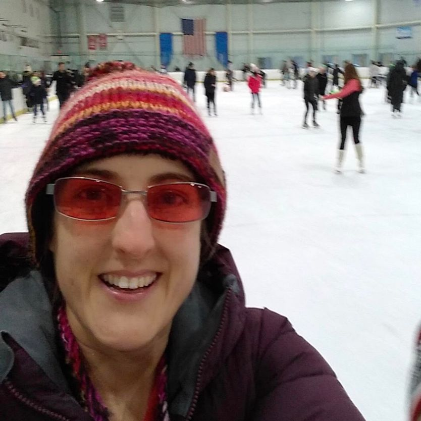 Maureen with TheraSpecs, skating with her family