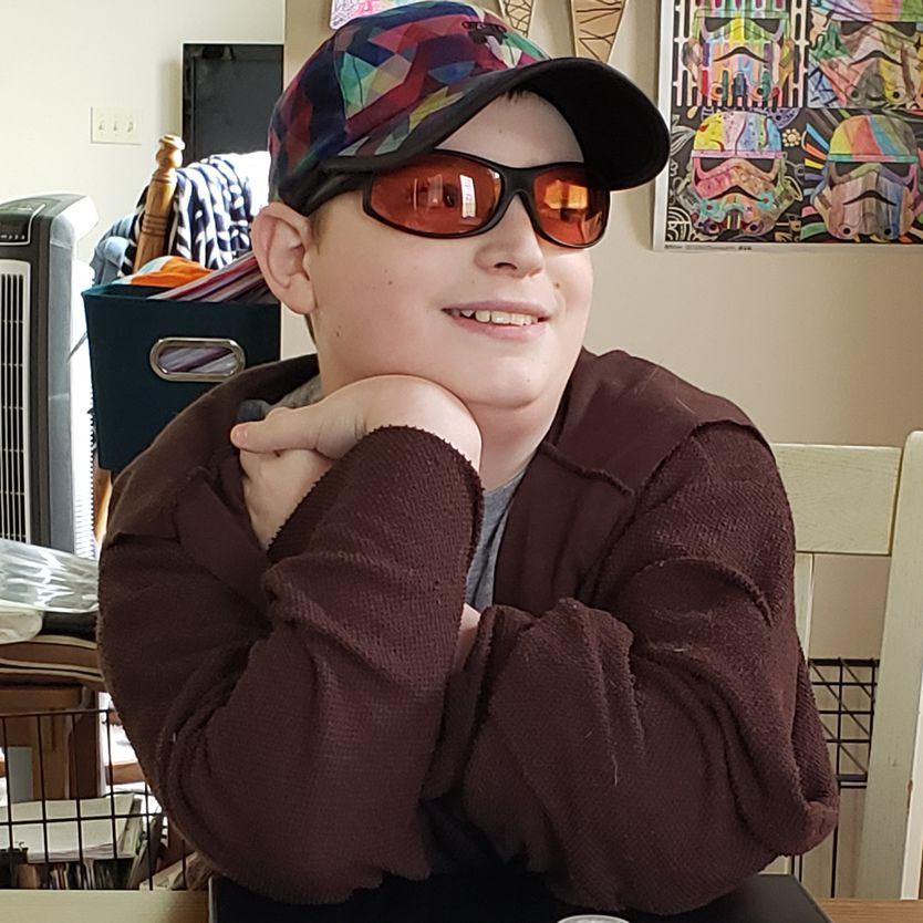 Michael wearing indoor Wrap TheraSpecs, smiling
