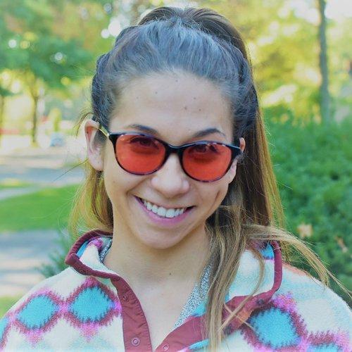 Olivia wearing Audrey Indoor Brown TheraSpecs