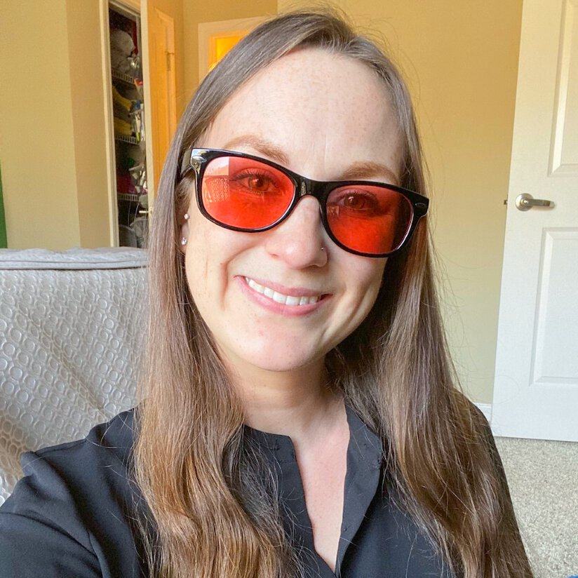 Sara wearing indoor TheraSpecs in the Classic frame