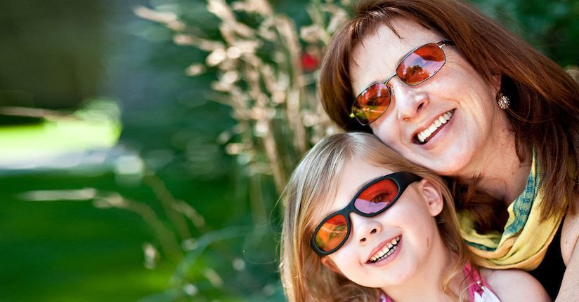 Mom and daughter wearing TheraSpecs for light sensitivity relief
