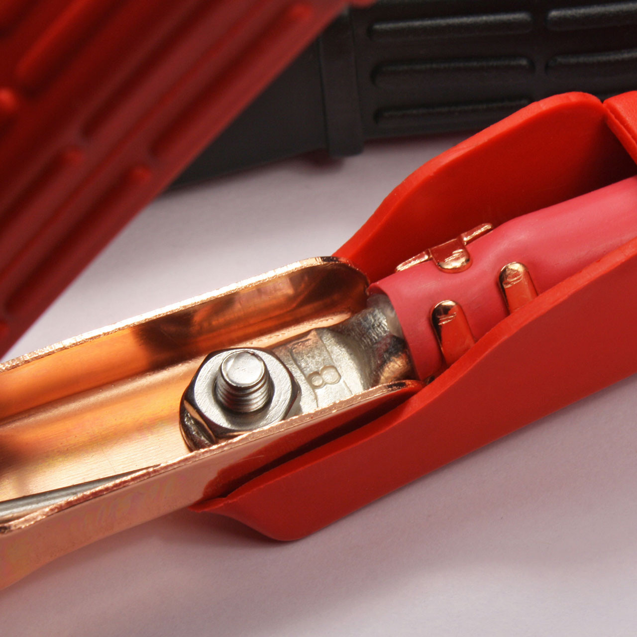 Solid copper jumper cable clamps are bolted to the cable's heat shrink sealed copper lugs for easy replacement