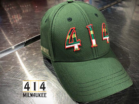 This is a tribute hat to the proud history of the Milwaukee Bucks. The Irish rainbow is a retro design feature running up and down the sides of the home and away uniform of the 1980s. Be proud of the city of Milwaukee and its basketball team. 100% Oxford lightweigh cotton.
