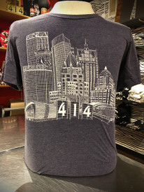 Cool grey blue Milwaukee skyline t-shirt featuring US Bank, NM Tower, Fiserv Forum, UW-Milwaukee Panther Arena, Mitchel Park Domes, Milwaukee Art Museum, 100 East Building, Milwaukee Center, Gas Light Building, Quarels and Brady tower, Rockwell, Allen Bradley, Polish Moon, and Discover World. Tri-blend shirt.