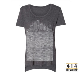 Charcoal grey Milwaukee skyline t-shirt featuring US Bank, NM Tower, Fiserv Forum, UW-Milwaukee Panther Arena, Mitchel Park Domes, Milwaukee Art Museum, 100 East Building, Milwaukee Center, Gas Light Building, Quarels and Brady tower, Rockwell, Allen Bradley, Polish Moon, and Discovery World. Tri-blend shirt vintage soft unisex t-shirt.  3.5 oz., 65% Poly/ 35% Combed Ring-Spun Cotton, 40 single. 1x1 baby rib. Hemmed sleeve. Side seamed. Raw edge, exaggerated tail drop hem.