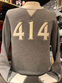 The 414 crew sweatshirt. Sueded fleece with wool embroidered 414 numbers on the front. 8.5 oz., 80/20 ringspun cotton/polyester. 3-end 100% cotton fleece face. Triple-needle stitching throughout. Natural woven twill back neck display. 2x2 rib collar, cuffs, waistband and v-notch. Forward shoulders. Relaxed waistband. Small shown here.