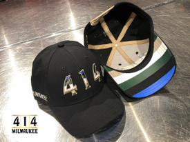 The 414 Black Rainbow hat is celebration of our beloved Milwaukee basketball team. Underneath the brim is a current rainbow featuring a vibrant color pattern symbolizing the city of the future. 100% Cotton hat. Snapback low profile. Arched brim.