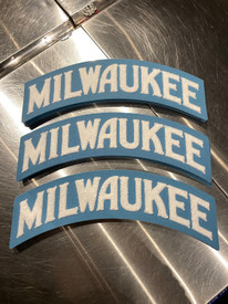 """The Milwaukee Arch 100% wool patch is W 14"""" x H 5.5"""" White and sky blue. Embroidered white chenille wool on sky blue felt. Apply to your favorite hoodie or jacket."""