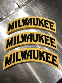 """The Milwaukee Arch 100% wool patch is W 14"""" x H 5.5"""" Black and Cream. Embroidered chenille wool on gold felt. Apply to your favorite hoodie or jacket."""