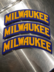 """The Milwaukee Arch 100% wool patch is W 14"""" x H 5.5"""" Embroidered chenille wool on gold felt. Apply to your favorite hoodie or jacket."""