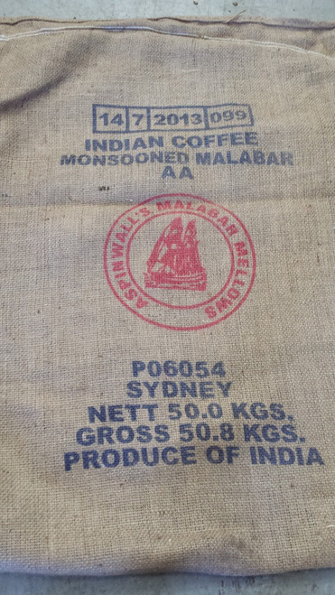 A full bag of raw green coffee beans from the farm.