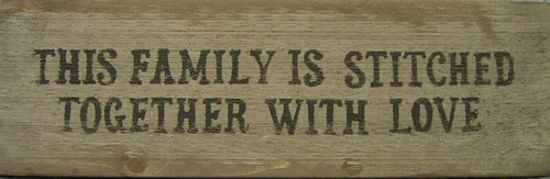 This Family Is Stitched Together With Love Wooden Sign