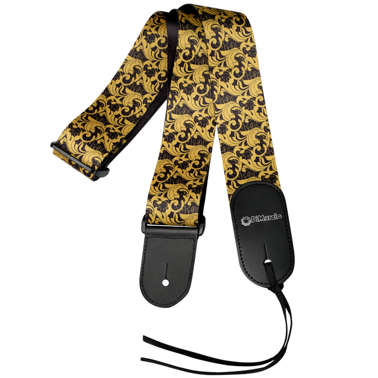 """High quality printed micro-fibre featuring a gold baroque swirling leaf pattern over a black background. Black stitched leather ends. Slide adjustable from 32"""" to 56½"""". Leather tie-cord included. UtoPIA Black and Gold"""