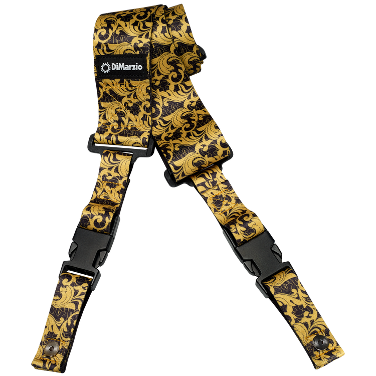 """This strap, the industry standard for strength, security and quality features a gold baroque swirling leaf pattern over a black background. Slide adjustable from 43½"""" to 63½"""". UtoPIA Black and Gold."""