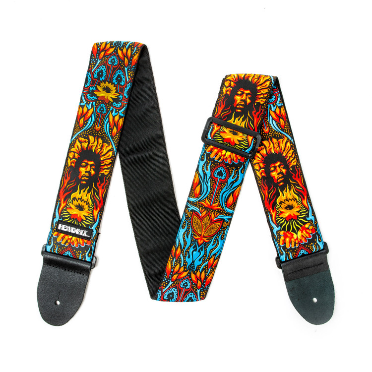 Fifty years ago, Jimi Hendrix closed out an epic two hour set that included his famous psychedelic rendition of the American national anthem. These guitar straps commemorate that event with artwork from award winning UK based design crue ILOVEDUST. 2½ inch high quality jacquard fabric with black poly backing. Black 100% leather ends. Slide adjustable. Emblazoned with psychedelic Lotus design. Blue/Red/Gold.