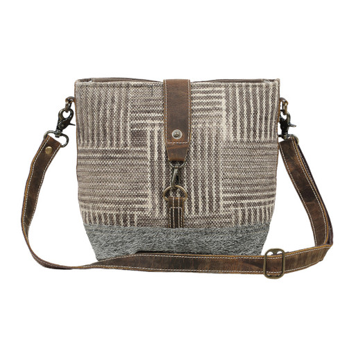 Goodwave Shoulder Bag. Printed rug fabric, genuine leather accents, and hair at the bottom.