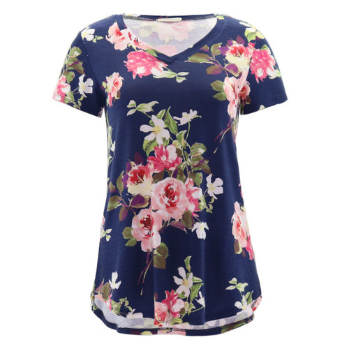 Lightweight soft floral tee. Features an all over floral print in shades of navy, blush, and olive.