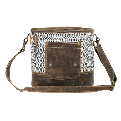 Zippered top closure, adjustable leather shoulder strap, and heavy duty antique brass hardware.