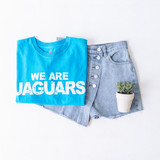 """- Crew Neck  - Short Sleeves  - Teal Tee - We Are Jags Design  - Design is on the Front  - Cropped   Top is a size Medium   Clothing Measurements: Bust: 19"""" Length: 21"""" Sleeve Length: 8"""""""