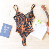 -Brown and Black -Zebra Print -V-Neck -Snap Closure -Bodysuit  Material: 95% Polyester 5% Spandex  OT31119 BSUIT TIGER