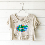 -Heather Gray -Distressed* -Scoop Neck -Short Sleeve -Cropped* -T-Shirt  Model is Wearing Size Large  Material: 95% Cotton 5% Acrylic  Clothing Measurements: Bust: Length: Sleeve Length:  *T-Shirt is cropped and distressed in-house; distressing may vary.