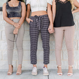 -Black -Double Grid -Plaid -Elastic Waist -High-Waist -Ties -Pockets -Straight Leg -Fabric Stretches -Unlined -Pockets  Model is Wearing Size Small  Material: 97% Polyester 3% Spandex  910297 PANT BPLD