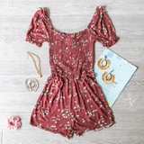 -Wine -Floral Print -Elastic Neckline -Square Neck -Smocked -Unlined -Fabric Stretches -Comes in 3 Colors -Romper  Material: 100% Rayon  AR35151P ROMP WINF