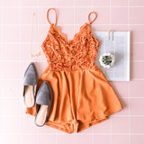 -Burnt Orange -Lace -V-Neck -Flowy -Spaghetti Straps -Adjustable Straps -Fit and Flare -Romper -Lined -Fabric Stretches -Comes in 3 Colors  Model is Wearing Size Small  Material: 95% Polyester 5% Spandex  IP7892 ROMP RST