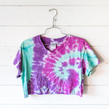 """-Multi-Color -Tie-Dye -V-Neck -Short Sleeve -Cropped -T-Shirt  Size Small  Material: 100% Cotton  Clothing Measurements: Bust: 18"""" Length: 15"""" Sleeve Length: 6"""""""