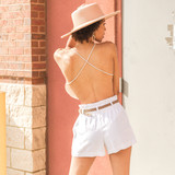 -Tan -Open Back -Criss Cross Back -Bungee Straps -Comes in 5 Colors -Unlined -Crop  Model is Wearing Size Small  Material: 5% Spandex 95% Rayon  TJ515HRS CROP TAN