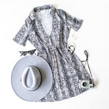 -Black and Gray Snake Print -Short sleeves -Collared neck -Deep V neck -Fabric stretches -Unlined -Dress  Model is Wearing Size Small  Material: 95% Polyester 5% Spandex  SD4654 DRESS SNK