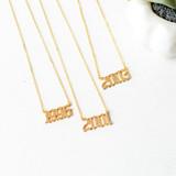 - Gold  - Rhinestones - Collar Bone Length - Clasp Closure  BIRTH YEAR CHARM