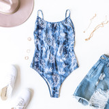 -Blue -Tie-Dye -Paisley Print -Scoop Neck -Low Back -Spaghetti Straps -Adjustable Straps -Snap Closure -Cheeky -Fabric Stretches -Unlined -Comes in 2 Colors -Bodysuit  Model is wearing Size Small  Material: 95% Polyester | 5% Spandex  T8612 BSUIT BLU