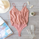 -Blush -Lace -Partially Lined -V-Neck -Spaghetti Straps -Adjustable Straps -Modesty Clasp -Thong -Snap Closure -Bodysuit -Comes in 3 Colors  Model is Wearing Size Medium  Material: 63% Nylon | 30% Metallic | 5% Spandex  IT90551 BSUIT PNK