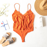 -Burnt Orange -Lace -Partially Lined -V-Neck -Spaghetti Straps -Adjustable Straps -Modesty Clasp -Thong -Snap Closure -Bodysuit -Comes in 3 Colors  Model is Wearing Size Medium  Material: 63% Nylon | 30% Metallic | 5% Spandex  IT90551 BSUIT RST