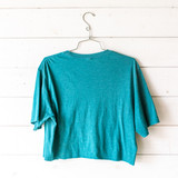 """-Teal -Crew Neck -Straight Out of Duval Graphic -Short Sleeve -Cropped -T-Shirt  Size Medium  Material: 100% Cotton  Clothing Measurements: Bust: 21"""" Length: 18.5"""" Sleeve Length: 9"""""""