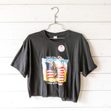 """-Black -Crew Neck -Land of the Free Graphic -Short Sleeve -Cropped -T-Shirt  Size Large  Material: Unknown  Clothing Measurements: Bust: 21"""" Length: 19.5"""" Sleeve Length: 8"""""""