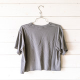 """-Gray -Crew Neck -Arrowhead Graphic -Short Sleeve -Cropped -T-Shirt  Size Medium  Material: 100% Cotton  Clothing Measurements: Bust: 20"""" Length: 19.5"""" Sleeve Length: 7"""""""