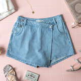 -Light Wash -Mid-Rise -Buttons -Pockets -Zipper -Fabric Does Not Stretch -Comes in 4 Colors -Skort  Model is Wearing Size Medium  Material: 86% Cotton | 14% Rayon  CP1907 SKORT LDNM