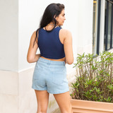-Light Wash -Mid-Rise -Buttons -Pockets -Zipper -Fabric Does Not Stretch -Comes in 4 Colors -Skort  Model is Wearing Size Medium  Material: 86% Cotton   14% Rayon  CP1907 SKORT LDNM